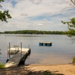 Northwoods Private Vacation Home beach area and raft dock with seated area
