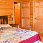 Northwoods Private Vacation Home one of 2 queen bedrooms on the upper level with access to bathroom for room