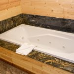 Northwoods Private Vacation Home one of the two bathrooms on the lower level with a jacuzzi and shower