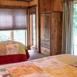 Northwoods Private Vacation Home lower walk out double and twin bedroom with walk out patio door lake side