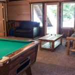 Northwoods Private Vacation Home lower level site side pool table and seating area