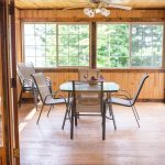 Northwoods Private Vacation Home Three Season Porch with lake view seating.