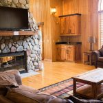 Northwoods Private Vacation Home main level living area and stone see through fire place