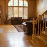 Northwoods Private Vacation Home view of main area and fireplace from entrance