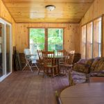 Cabin 14 Reunion Home 3 season room with extra tables and chairs